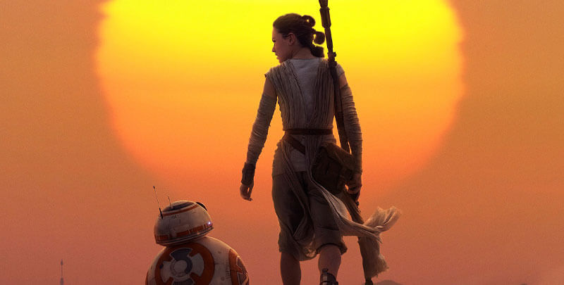 Rey and BB-8 in front of the sun setting