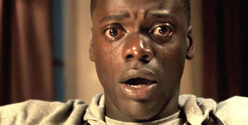Daniel Kaluuya sits with eyes wide and tears streaming down his face