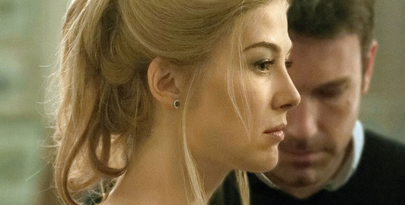 a profile of Amy with her husband Nick in the background