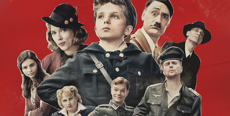 a young boy surrounded by supporting characters including Adolf Hitler