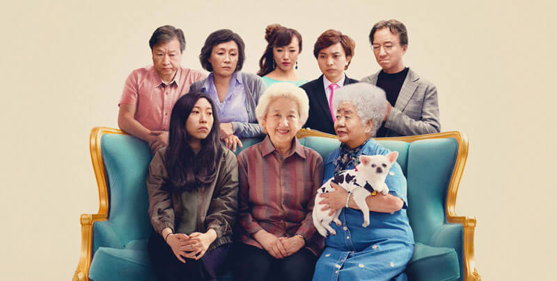 a Chinese family on a couch, surrounding the grandmother